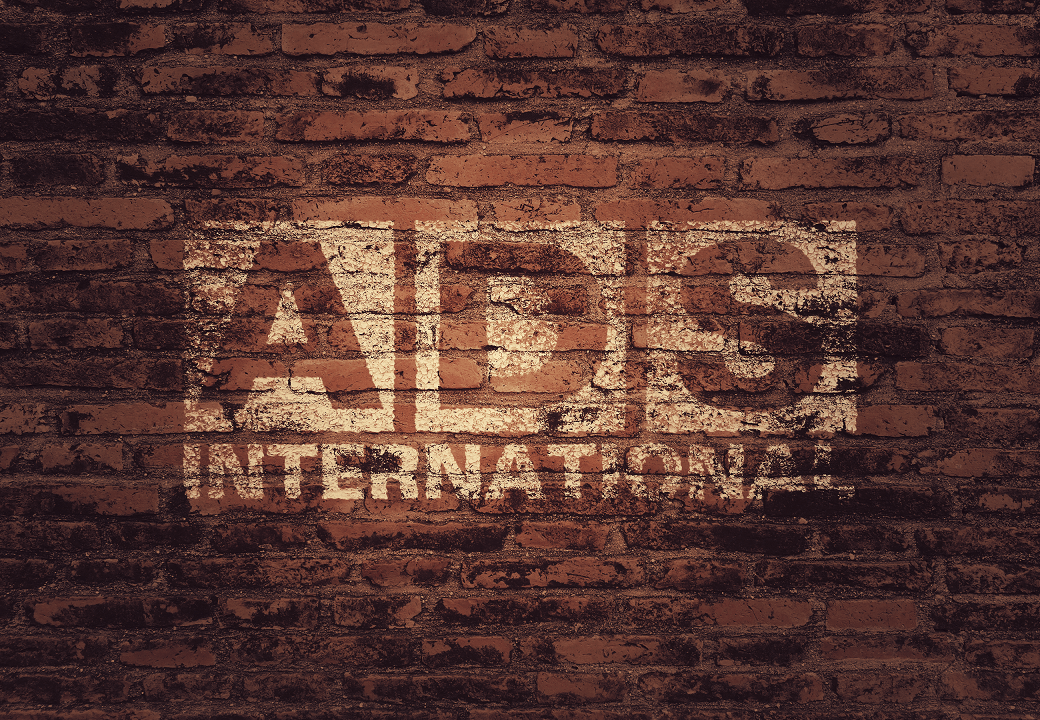 Logo-on-brick-wall-ADS-International