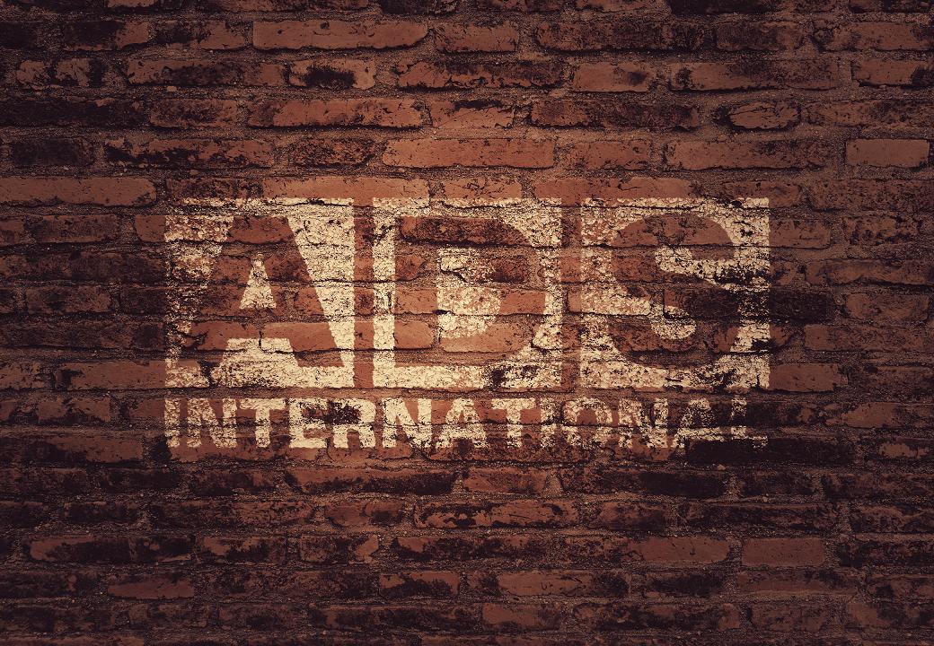 Logo-on-brick-wall-ADS-International